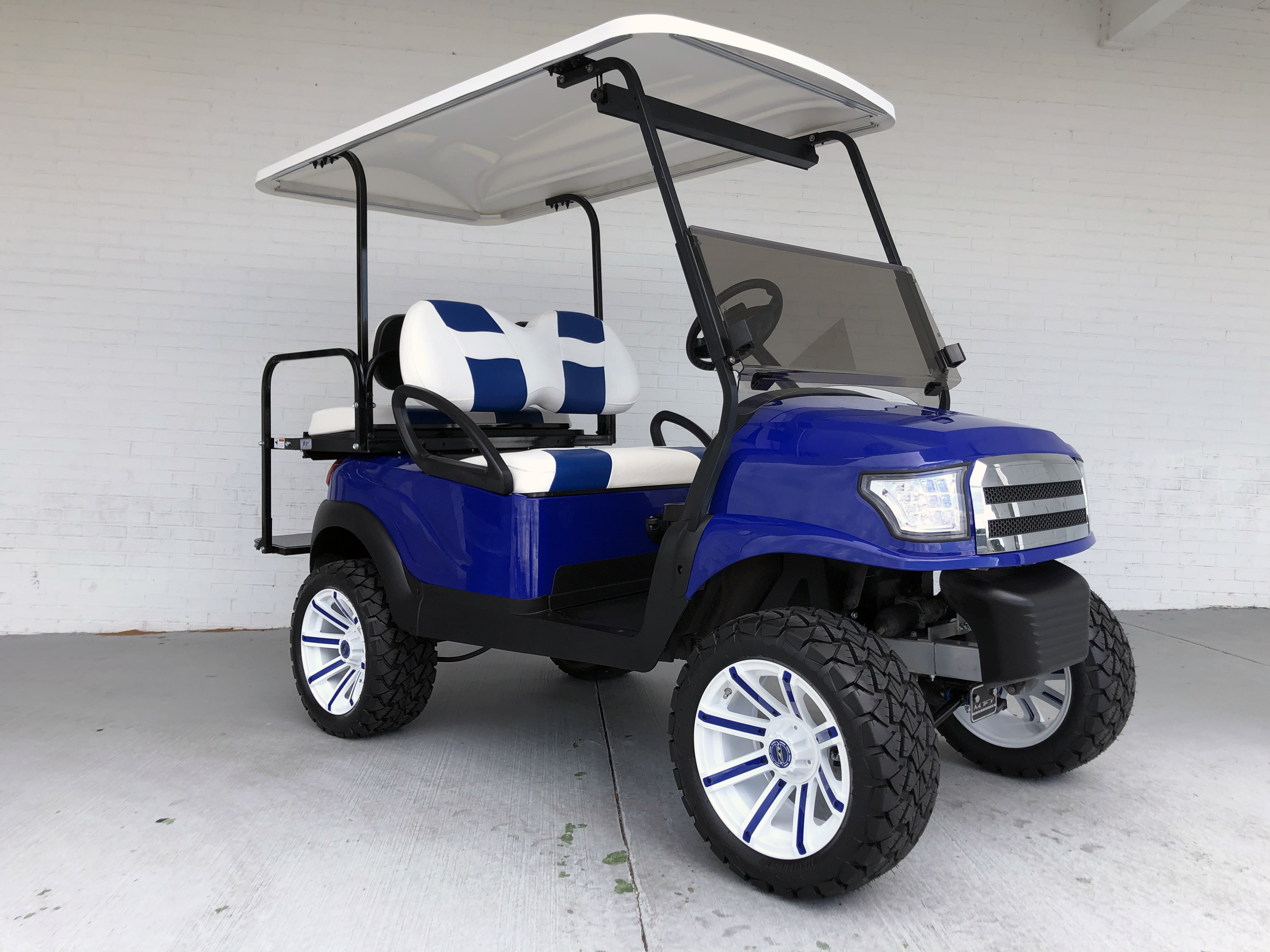 BLUE AND WHITE ALPHA LIFTED PRECEDENT GOLF CART