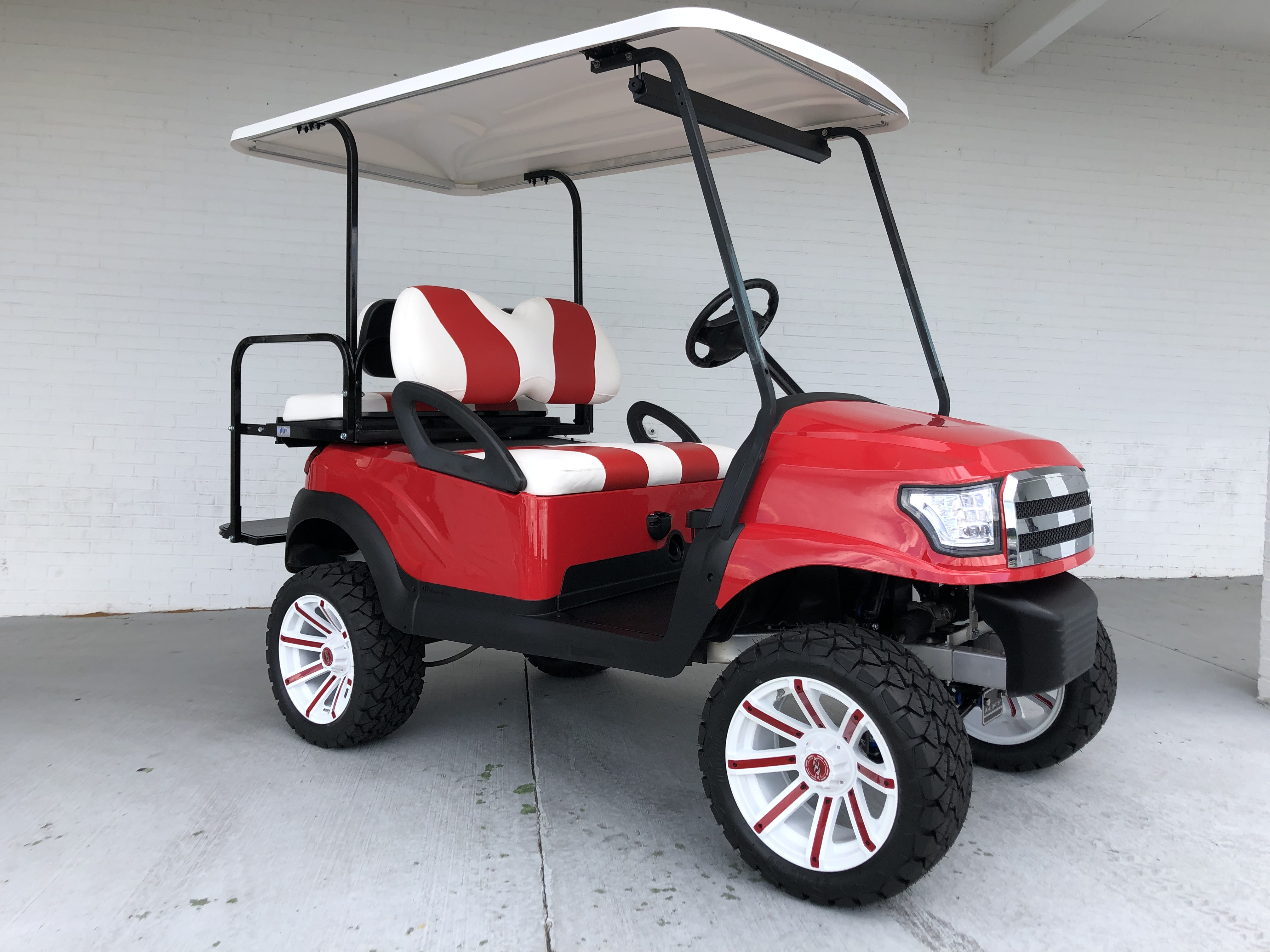 RED AND WHITE ALPHA LIFTED PRECEDENT GOLF CART