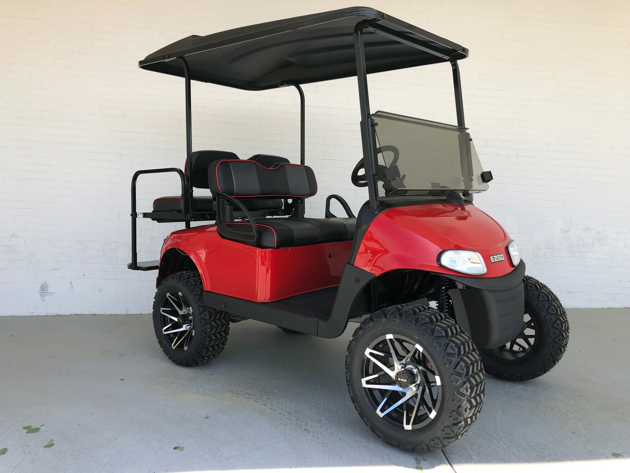 Lifted Red EZ-GO TXT Golf Cart