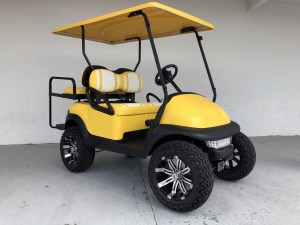 YELLOW AND WHITE DOUBLE TAKE LIFTED CLUB CAR PRECEDENT GOLF CART 01